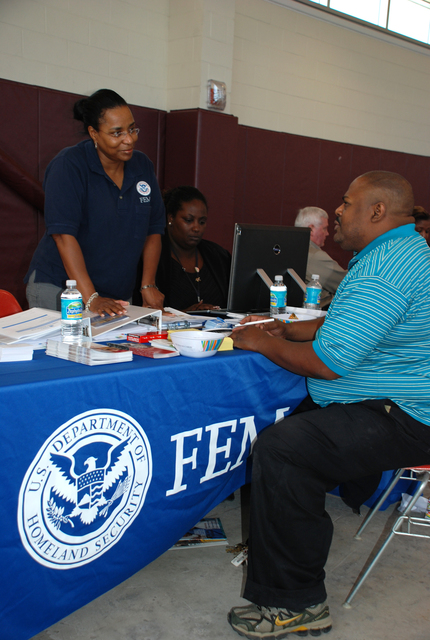 [Heavy Rain, Flooding] New Orleans, LA, October 27, 2007 -- Federal Emergency Management Agency Individual Assistance representative Jeanell Holmes provides Orleans Parish resident Keith Mason information on rental assistance during the Crescent City Comeback informational fair on Oct. 27, 2007. Other participants included the New Orleans Office of Homeland Security and Emergency Preparedness, Road Home, Housing Authority of New Orleans, Small Business Administration, New Orleans Recovery Schools, Social Security Administration, and Operation Hope. Photo: Gina Cortez/FEMA.