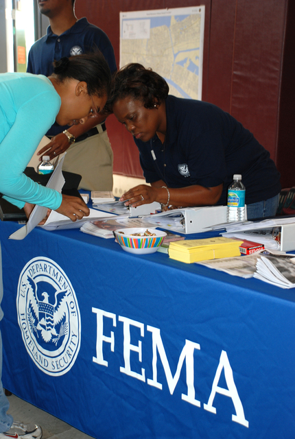 [Hurricane Katrina] New Orleans, LA, October 27, 2007 --  Federal Emergency Management Agency Individual Assistance representative Teryl Franklin assists Orleans Parish resident Railynn Holmes with rental assistance documentation during the Crescent City Comeback Informational Fair on Oct. 27, 2007.  New Orleans Office of Homeland Security and Emergency Preparedness, Road Home, Housing Authority of New Orleans, Small Business Administration, New Orleans Recovery Schools, Social Security Administration, and Operation Hope. Photo: Gina Cortez/FEMA.
