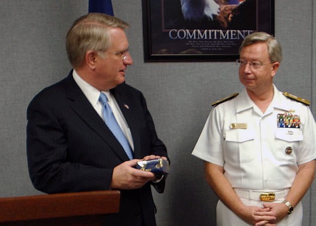 Mr. John P. Walters (left), Director of the Office of National Drug Control Policy, presents the Director's Award for Distinguished Service for efforts in counter-narcotics operations to U.S. Navy Rear Adm. James W. Stevenson Jr., Commander, U.S. Naval Forces Southern Command, during a ceremony at Naval Station Mayport, Fla., on Oct., 27, 2006. Admiral Stevenson coordinated with joint forces to disrupt the smuggling of 99 metric tons of cocaine in 2005 and more than 106 metric tons through October 2006. (U.S. Navy PHOTO by Mass Communication SPECIALIST 2nd Class Denise Ordonez) (Released)