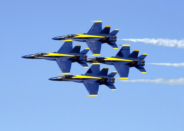 The U.S. Navy Flight Demonstration Team, The Blue Angels in their F/A-18C Hornet aircraft, perform a coordinated maneuver during their performance at the Naval Air Station Jacksonville Air Show, Fla., Oct. 28, 2006. (U.S. Navy photo by Mass Communication SPECIALIST 3rd Class David Didier) (Released)