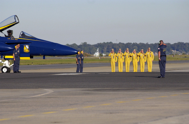 U.S. Navy Blue Angels pilots ceremoniously salute following their flight demonstration at the Naval Air Station Jacksonville Air Show, Fla., Oct. 29, 2006. (U.S. Navy photo by Mass Communication SPECIALIST 3rd Class David Didier) (Released)
