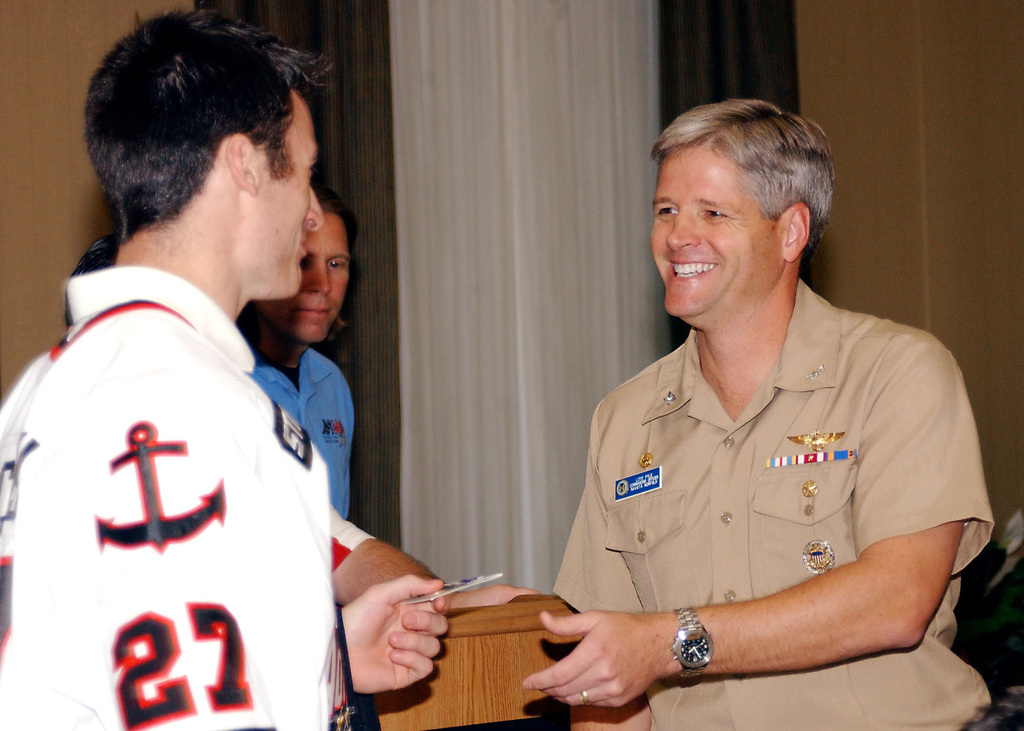 """Brandon Bochenski (left), from the American Hockey League's Norfolk Admirals, receives a command coin from U.S. Navy CAPT. Loyd Pyle, Commanding Officer of Naval Station Norfolk, Va., at the""""Meet the Admirals Luncheon""""event held at Naval Station Norfolk, Va., on Oct. 30, 2006. The event is sponsored by Morale, Welfare and Recreation and gives Sailors an opportunity to meet Members of Professional Sports Teams. (U.S. Navy PHOTO by Mass Communication SPECIALIST Seamen Octavio N. Ortiz) (Released)"""