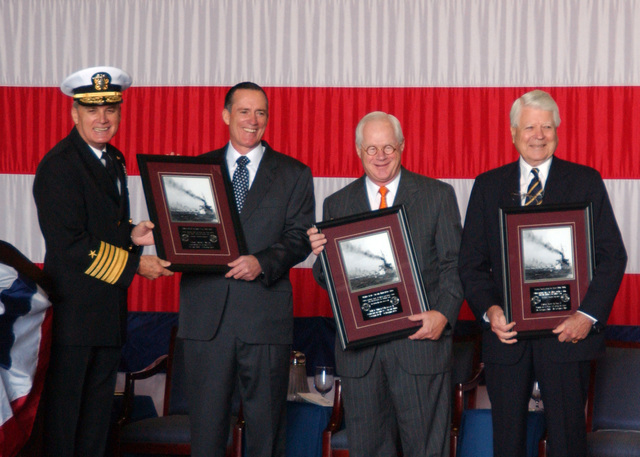 U.S. Navy Adm. John B. Nathman (left) and former admirals of U.S. Navy Atlantic Fleet and Fleet Forces Command accept awards at a ceremony for the dis-establishment of the U.S. Atlantic Fleet and Fleet Forces Command at Naval Station Norfolk, Va., on Oct. 31, 2006. The dis-establishment and renaming is part of a realignment of the functions of the two commands and streamlines the chain of command. Unification of the duties of the two commands in Commander, U.S. Fleet Forces Command clarifies and advances the process of providing a primary advocate and representative for Fleet personnel, training, requirements, maintenance and operational issues. (U.S. Navy PHOTO by Mass Communication...