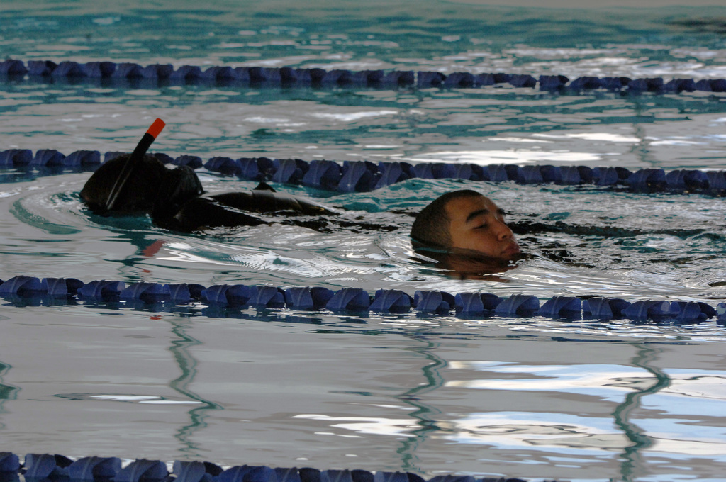 U.S. Navy (USN) BoatswainΘs Mate SEAMAN Nathan Salmon and USN Storekeeper SEAMAN Fredy Hussey, from the USN Ticonderoga Class Guided Missile Cruiser USS CAPE ST. GEORGE (CG 71), participate in the 800-meter buddy tow swim during the rescue swimmer competition for Surface Line Week 2006 at Naval Station Norfolk on Oct. 31, 2006. Surface Line Week uses competition and camaraderie among Hampton Roads-based surface ships, allowing surface warriors to demonstrate their expertise and spirit in a series of eight athletic and 13 professional events. (U.S. Navy photo by Mass Communication SPECIALIST Seamen Kenneth R. Hendrix) (Released)