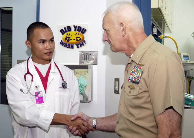 U.S. Navy Hospital Corpsman Diosdado Peralta (left), shakes hands with U.S. Navy Surgeon General, Vice Adm. Donald Arthur, during the admiral's visit to the labor and delivery ward of at the U.S. Naval Hospital Yokosuka, Japan, on Nov. 1, 2006. The admiral spent the day touring the hospital, meeting with staff and thanking them for their hard work and dedication. (U.S. Navy PHOTO by Mass Communication SPECIALIST 2nd Class Chantel M. Clayton) (Released)