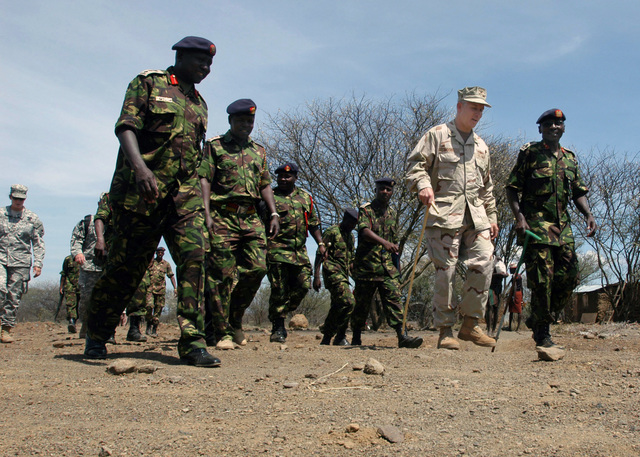U.S. Navy Rear Adm. Tim Moon (center), Deputy Commander of Combined Joint Task Force - Horn of Africa (JTF-HOA), receives a tour on Nov. 3, 2006, from Kenyan Army Brig. GEN. Leornard Ngondi (right) before a dedication ceremony for the East African Nomadic Community Primary School. Kenyan Department of Defense and JTF-HOA built the primary school in about four weeks. JTF-HOA is a unit of U.S. Central Command. (U.S. Navy PHOTO by CHIEF Mass Communication SPECIALIST Eric A. Clement) (Released)