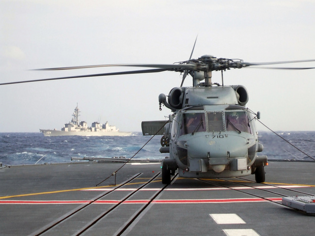 A U.S. Navy SH-60B Seahawk helicopter from Helicopter Anti-Submarine Squadron Light 51, sits on the deck of the Japanese Maritime Self-Defense Force ship JDS KURAMA (DDH 144) as JDS SAMIDARE (DD 106) sails behind during exercise ANNUALEX. The exercise is designed to improve both forces capabilities in the defense of Japan, Pacific Ocean, Nov. 12, 2006. (U.S. Navy photo by Aviation Warfare Systems Operator 2nd Class Jacob Gonzales) (Released)