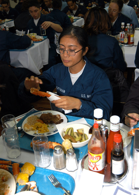 Celebrating the 36th birthday of the U.S. Navy (USN) Amphibious Command Ship USS BLUE RIDGE (LCC 19), USN SEAMAN Rachel Hoffman enjoys some crab legs on the mess deck on Nov. 14, 2006. The meal was held in conjunction with a celebration for all crewmembers that had a birthday in September, October or November. The BLUE RIDGE, commissioned Nov. 14, 1970, is the third ship to bear the name and currently the 7th Fleet Command ship, forward deployed to Yokosuka, Japan. (U.S. Navy photo by Mass Communication SPECIALIST 3rd Class Tucker M. Yates) (Released)
