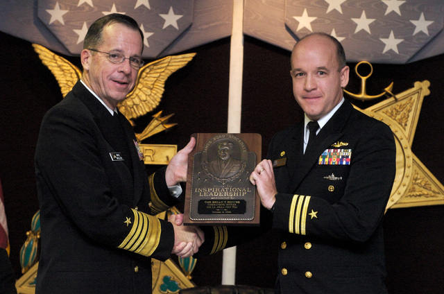 U.S. Navy Adm. Mike Mullen CHIEF of Naval Operations (CNO), presents the Vice Adm. James B. Stockdale Award for Leadership to CMDR. Brian T. Howes, Commanding Officer (CO) of the Los Angeles class attack submarine USS LA JOLLA (SSN 701), in the Hall of Heroes at the Pentagon on Nov. 14, 2006.  (U.S. Navy PHOTO by Mass Communication SPECIALIST 1ST Class Chad J. McNeeley) (Released)