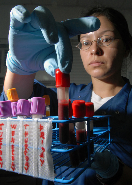 U.S. Navy PETTY Officer 2nd Class Diana Rodriguez, a Medical Laboratory Technician, works a specimen analysis at the U.S. Naval Hospital Guam, Branch Medical Clinic laboratory located on Naval Base Guam.  Rodriguez performs routine tests in the laboratory to provide data for use in diagnosis and treatment of patients. (U.S. Navy PHOTO by Mass Communication SPECIALIST 2nd Class John F. Looney)  (Released)