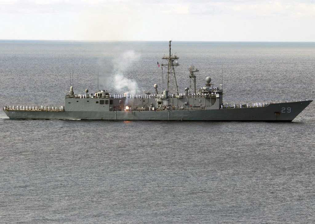 U.S. Navy (USN) Sailors aboard the USN Oliver Hazard Perry Class Guided Missile Frigate USS STEPHEN W. GROVES (FFG 29) man the rails as the ship fires a gun salute, on Nov. 16, 2006, in a re-enactment of the salute given to Andrew Doria by Governor Johannes de Graaff of Sint Eustatius Nov. 16, 1776. The salute is the first formal recognition of what would become the United States of America by a sovereign nation. (U.S. Navy photo by Mass Communication SPECIALIST Second Class Regina L. Brown) (Released)