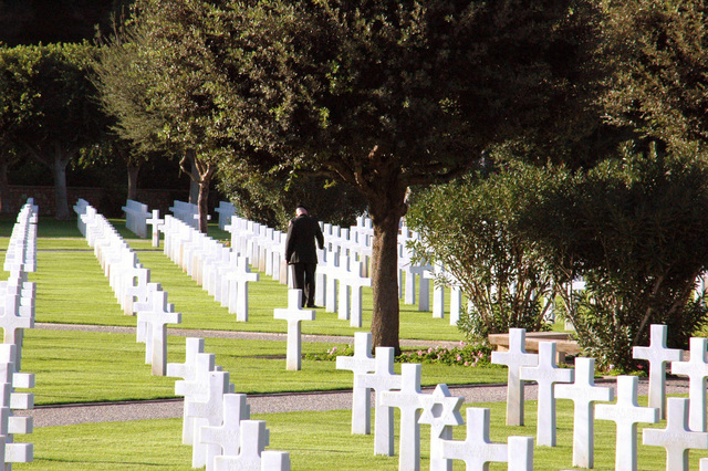 A U.S. Army Soldier assigned to the American Embassy in Tunis touches a headstone at the North African American Cemetery during a wreath-laying ceremony honoring American veterans on Nov. 17, 2006. The North Africa American Cemetery is one of 24 American cemeteries on foreign soil and covers 27 acres of land between the Mediterranean Sea and the Bay of Tunis. Established in 1948, the cemetery holds the graves of 2,841 service members who died while serving during the World War II North Africa campaign. (U.S. Navy photo by Mass Communication SPECIALIST Second Class Rosa Larson) (Released)