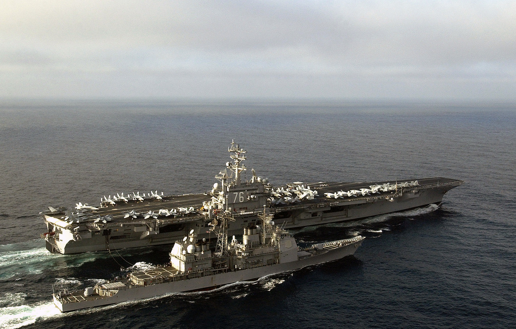 Aerial starboard view as the U.S. Navy Nimitz Class Aircraft Carrier USS RONALD REAGAN (CVN 76), (top), receives fuel from the Ticonderoga Class Guided Missile Cruiser USS LAKE CHAMPLAIN (CG 57), during a fueling-at-sea evolution in the Pacific Ocean on Nov. 17, 2006. (U.S. Navy photo by Mass Communication SPECIALIST 2nd Class (AW/SW) Aaron Burden) (Released)