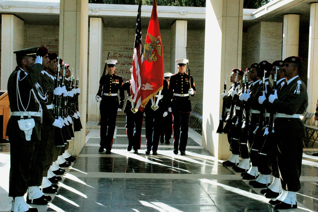 The U.S. Marine Corps color guard assigned to the American Embassy in Tunis march through a corridor of Tunisian honor guards while retiring the colors during a wreath-laying ceremony at the North African American Cemetery in Tunis on Nov. 17, 2006. The North Africa American Cemetery is one of 24 American cemeteries on foreign soil and covers 27 acres of land between the Mediterranean and the Bay of Tunis. Established in 1948, the cemetery holds the graves of 2,841 service members who died while serving during the World War II North Africa campaign. (U.S. Navy photo by Mass Communication SPECIALIST Second Class Rosa Larson) (Released)