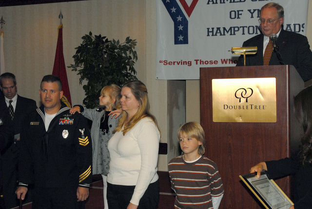 U.S. Navy MASTER-at-Arms First Class Mike Marino and family receive the award for best community service and support for the Navy at the Five Star Military Family Recognition luncheon. The luncheon is being held at Naval Station Virginia Beach, Va., on Nov. 17, 2006, to recognize five families, one from each branch of the service, for their outstanding community service and support. (U.S. Navy PHOTO by Mass Communication SPECIALIST SEAMAN Apprentice Matthew R. Bookwalter) (Released)
