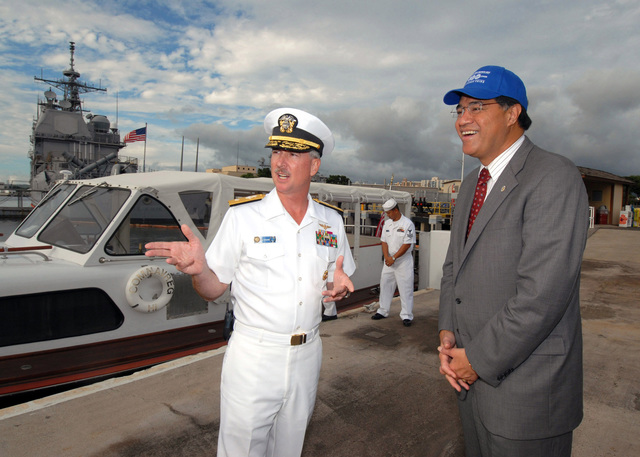U.S. Navy Rear Adm. T.G. Alexander, Commander, Navy Region Hawaii, meets with Mufi Hannemann, Mayor of the City and County of Honolulu at Merry Point Landing, Hawaii, before departing with personnel on Nov. 20, 2006, onboard a barge tour of Pearl Harbor.  The barge tour allows visitors of Commander, Navy Region Hawaii an opportunity to experience an up-close view of various historical sights and memorials of the Navy within Pearl Harbor. (U.S. Navy PHOTO by Mass Communication SPECIALIST 1ST Class James E. Foehl) (Released)