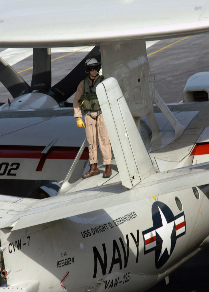 "A U.S. Navy Pilot assigned to the""Tigertails""of Carrier Airborne Early Warning Squadron 125, inspects an E-2C Hawkeye before flight operations aboard the Nimitz Class Aircraft Carrier USS DWIGHT D. EISENHOWER (CVN 69), in the Arabian Sea, Nov. 22, 2006. (U.S. Navy photo by Mass Communication SPECIALIST SEAMAN David Danals) (Released)"