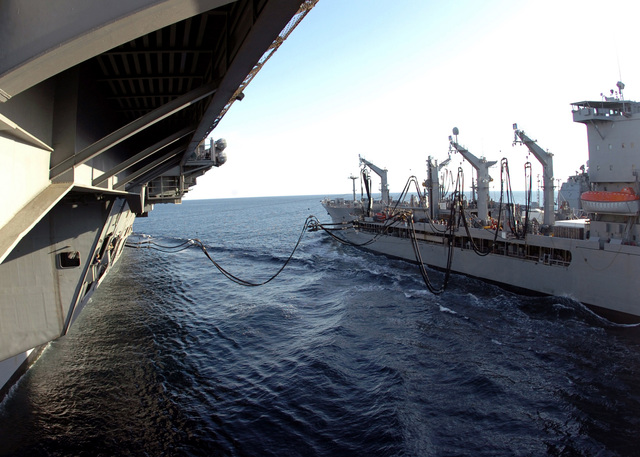 The U.S.Navy Nimitz Class Aircraft Carrier USS DWIGHT D. EISENHOWER (CVN 69), (left), takes on fuel and other supplies from the Military Sealift Command Henry J. Kaiser Class Oiler USNS LARAMIE (T-AO 204) during an underway replenishment operation in the Arabian Sea on Nov. 27, 2006. (U.S. Navy photo by Mass Communication SPECIALIST SEAMAN David Danals) (Released)