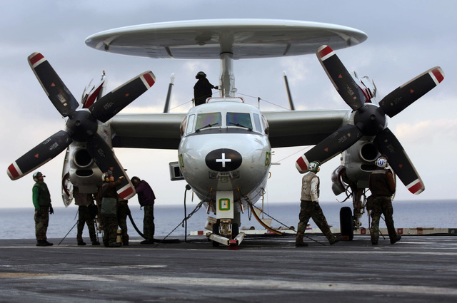 U.S. Navy Sailors service a Carrier Airborne Early Warning Squadron 115 E-2C Hawkeye, aboard the Aircraft Carrier USS KITTY HAWK (CV 63) during routine flight operations in the Philippine Sea, Nov. 29, 2006. (U.S. Navy photo by Mass Communication SPECIALIST 3rd Class Jarod Hodge) (Released)