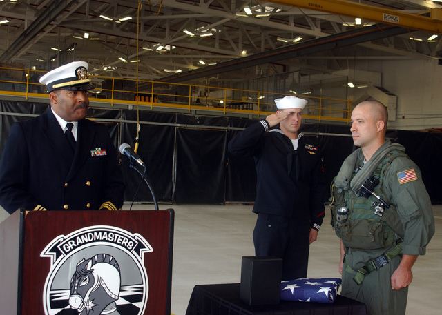U.S. Navy LT. CMDR. Paul Anderson Chaplin (left), assigned to Naval Station Mayport, and Sailors assigned to Helicopter Anti-Submarine Squadron Light 46, participate in a burial-at-sea ceremony for CHIEF Aviation Structural Mechanic (Hydraulics) John H. Kingery, Naval Station Mayport, Fla., Nov. 30, 2006. (U.S. Navy photo by Mass Communication SPECIALIST 2nd Class Lynn Friant) (Released)