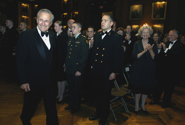 The Honorable Donald H. Rumsfeld (left), U.S. Secretary of Defense, receives applause as he arrives to the Union League of Pennsylvania Gold Medal Award Presentation in Philadelphia, Penn., Dec. 1, 2006.  (DoD photo by Cherie A. Thurlby) (Released)