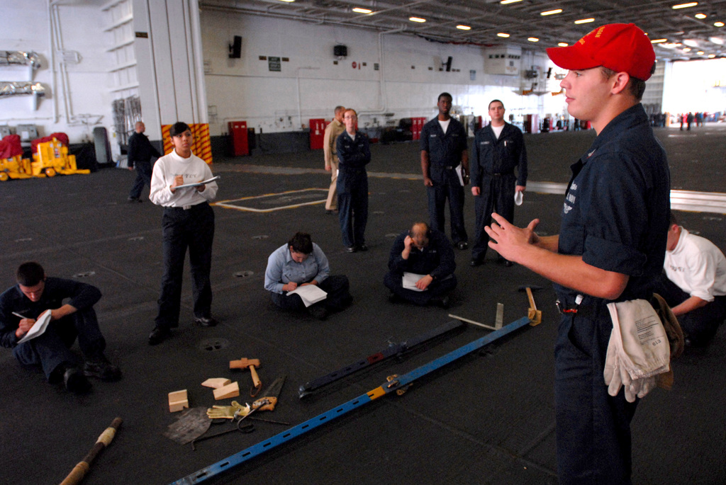 U.S. Navy Damage Controlman 3rd Class Christopher Conrad, (right), instructs Sailors on how to use shoring during training in the hangar bay onboard the Nimitz Class Aircraft Carrier USS RONALD REAGAN (CVN 76) on Dec. 2, 2006. The REAGAN is currently conducting training squadron carrier qualifications off the coast of Southern California. (U.S. Navy photo by Mass Communication SPECIALIST SEAMAN Benjamin Brossard) (Released)