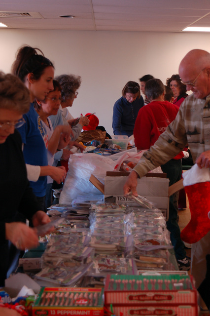 U.S. Navy volunteers from the local community stuff stockings for deployed troops, at Norfolk, Va. Chapel Annex on Dec 2, 2006. (U.S. Navy PHOTO by Mass Communication SPECIALIST SEAMAN Apprentice Scott C. Rancilio) (Released)