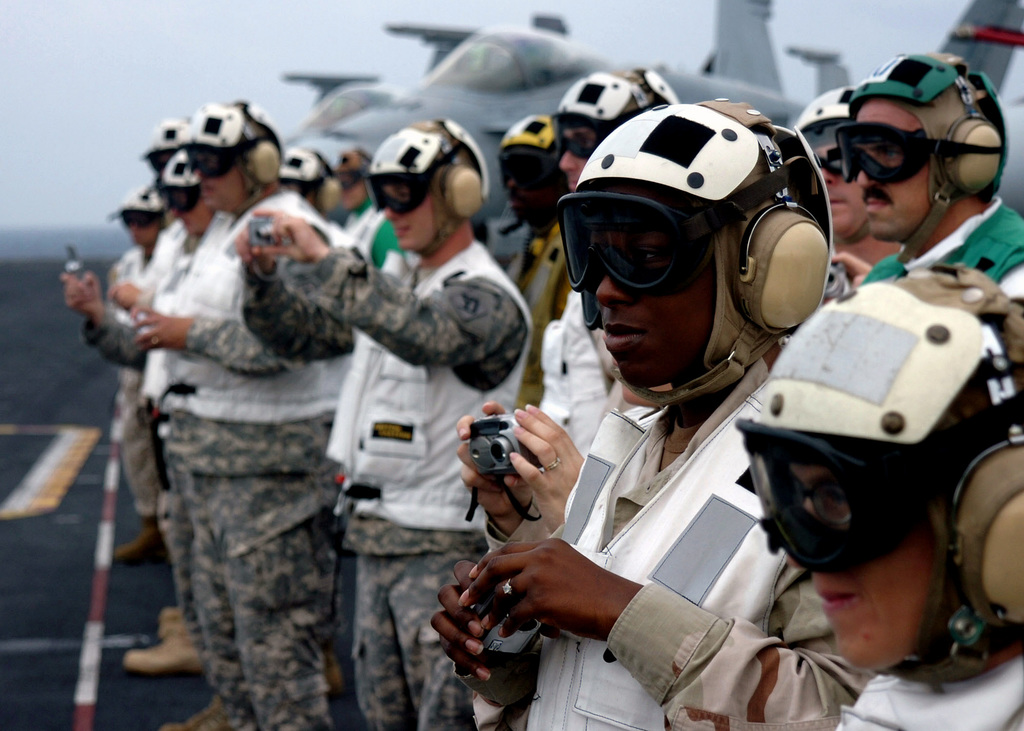 U.S. Central Command SENIOR Enlisted Advisors observe flight operations during a tour of the Nimitz Class Aircraft Carrier USS DWIGHT D. EISENHOWER (CVN 69) on December 4, 2006. The Eisenhower and embarked Carrier Air Wing 7 are underway in the Arabian Sea on a regularly scheduled deployment in support of Maritime Security Operations. U.S. Navy photo by Mass Communication SPECIALIST SEAMAN David Danals (Released)