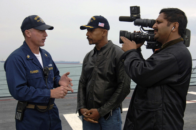 Montel Williams (center) interviews U.S. Navy (USN) Command MASTER CHIEF David Flannery (left) aboard the USN Arleigh Burke Class Guided Missile Destroyer SS HOWARD (DDG 83). Williams, a talk show host and a former Navy Lieutenant Commander, traveled to the 5th Fleet area of operations to collect footage for a holiday special dedicated to U.S. service members deployed to the Persian Gulf on Dec. 5, 2006. (U.S. Navy photo by Mass Communication SPECIALIST Second Class Kitt Amaritnant) (Released)
