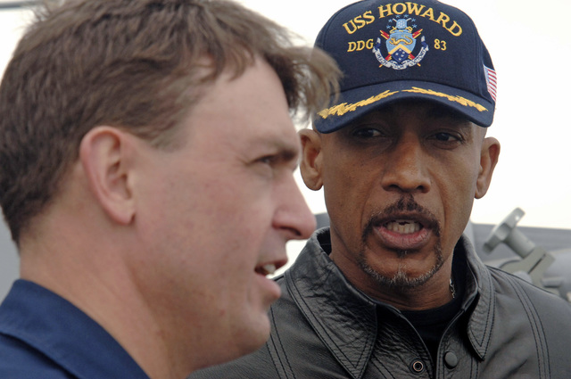 Montel Williams (right) interviews U.S. Navy CMDR. James Morgan, Commanding Officer of the Arleigh Burke Class Guided Missile Destroyer SS HOWARD (DDG 83). Williams, a talk show host and a former Navy Lieutenant Commander, traveled to the 5th Fleet area of operations to collect footage for a holiday special dedicated to U.S. service members deployed to the Persian Gulf on Dec. 5, 2006. (U.S. Navy photo by Mass Communication SPECIALIST Second Class Kitt Amaritnant) (Released)