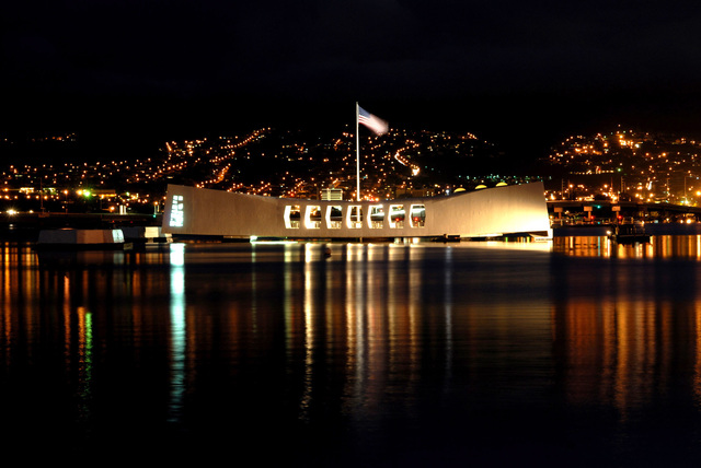 The city lights of Aiea, Hawaii, is the backdrop for USS ARIZONA Memorial, the morning prior to the joint U.S. Navy/National Park Service ceremony commemorating the 65th anniversary of the attack on Pearl Harbor, Hawaii, on Dec. 6, 2006.  More than 1,500 Pearl Harbor survivors, their families and friends from around the nation will join more than 2,000 distinguished guests and the general public for the annual observance. (U.S. Navy PHOTO by Mass Communication SPECIALIST 1ST Class James E. Foehl) (Released)