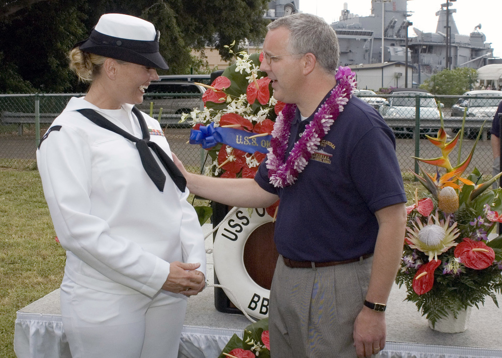 The Honorable Brad Henry (right), Governor of Oklahoma, speaks with U.S. Navy Gas Turbine System Technician (Mechanical) 3rd Class Mary Ashley Angelo, whose grandfather donated the land that the Oklahoma Capitol Building sits, at Ford Island, Hawaii, on Dec. 7, 2006, during the joint Navy/National Park Service ceremony commemorating the 65th Anniversary of the attack on Pearl Harbor.  More than 1,500 Pearl Harbor survivors, their families and their friends from around the nation joined the more than 2,000 distiguished guests and the general public for the annual observance. (U.S. Navy photo by CHIEF Communication SPECIALIST Don Bray) (Released)