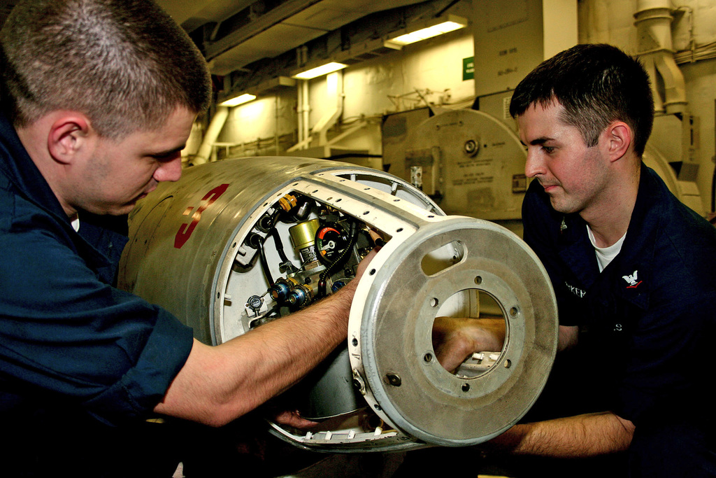 Onboard the U.S. Navy Nimitz Class Aircraft Carrier, USS DWIGHT D. EISENHOWER (CVN 69), Aviation Electrician's Mate Third Class Jeffrey Barker (left) and Aviation Machinist's Mate AIRMAN Eric Campbell install a hydraulic reservoir on an aerial refueling store, on December 8, 2007. The Eisenhower and embarked Carrier Air Wing 7 are underway in the Arabian Sea on a regularly scheduled deployment in support of Maritime Security Operations. (U.S. Navy PHOTO by Mass Communication SPECIALIST Third Class Jason Johnston) (Released)