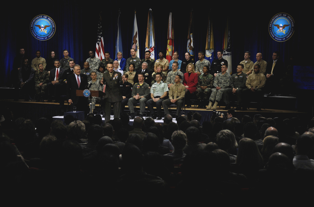 The Honorable Donald H. Rumsfeld (at podium, left), U.S. Secretary of Defense (SECDEF), and U.S. Marine Corps GEN. Peter Pace (right), Chairman of the Joint Chiefs of STAFF, address the audience at his final Pentagon Town Hall Metting, Washington, D.C., Dec. 8, 2006.  The SECDEF hosted more than 40 Town Hall Meetings in his almost six years in office.  (DoD photo by Cherie A. Thurlby) (Released)