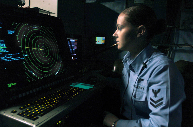 U.S. Navy Air Traffic Controller 2nd Class Emily Trolinger stands her watch as an aircraft departure controller in the Carrier Air Traffic Control Center aboard the Nimitz Class Aircraft Carrier USS THEODORE ROOSEVELT (CVN 71) on Dec. 9, 2006, while the ROOSEVELT is maintaining qualifications as part of the U.S. Navy fleet Response Plan. (U.S. Navy photo by Mass Communications SPECIALIST SEAMAN Sheldon Rowley) (Released)