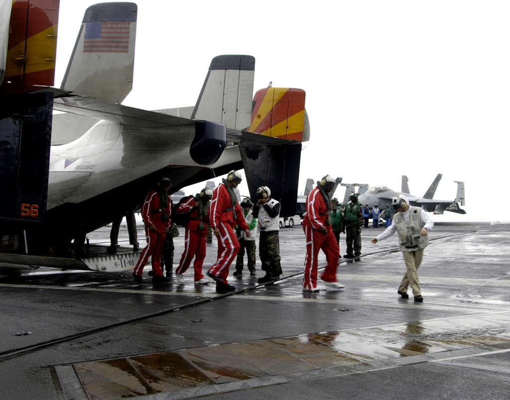 Members of the legendary Harlem Globetrotters Basketball Team, arrive aboard the U.S. Navy Nimitz Class Aircraft Carrier, USS DWIGHT D. EISENHOWER (CVN 69), on December 11, 2006. The Globetrotters visited the ship as part of their 21-day Morale, Welfare and Recreation tour of the Middle East in an effort to show thanks to the men and women of the military. The Eisenhower and embarked Carrier Air Wing 7 are underway in the Arabian Sea on a regularly scheduled deployment in support of Maritime Security Operations. (U.S. Navy PHOTO by Mass Communication SPECIALIST SEAMAN Clarence McCloud) (Released)