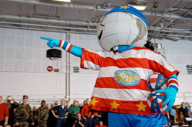 Onboard the U.S. Navy Nimitz Class Aircraft Carrier, USS DWIGHT D. EISENHOWER (CVN 69), ΦGlobieτ, the Harlem Globetrotters Basketball Team Mascot, gets the crowd pumped up in anticipation for the game aboard ship on December 12, 2006. The Globetrotters visited the ship as part of their 21-day Morale, Welfare and Recreation tour of the Middle East in an effort to show thanks to the men and women of the military. The Eisenhower and embarked Carrier Air Wing 7 are underway in the Arabian Sea on a regularly scheduled deployment in support of Maritime Security Operations. (U.S. Navy PHOTO by Mass Communication SPECIALIST SEAMAN Apprentice Laura Thuman) (Released)