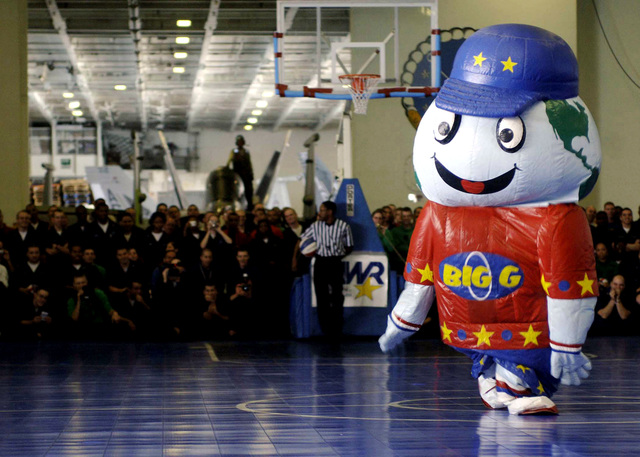 Onboard the U.S. Navy Nimitz Class Aircraft Carrier, USS DWIGHT D. EISENHOWER (CVN 69), ΦBig Gτ, the Harlem Globetrotters Basketball Team Mascot, gets the crowd pumped up in anticipation for the game aboard ship on December 12, 2006. The Globetrotters visited the ship as part of their 21-day Morale, Welfare and Recreation tour of the Middle East in an effort to show thanks to the men and women of the military. The Eisenhower and embarked Carrier Air Wing 7 are underway in the Arabian Sea on a regularly scheduled deployment in support of Maritime Security Operations. (U.S. Navy PHOTO by Mass Communication SPECIALIST Third Class Matthew D. Leistikow) (Released)