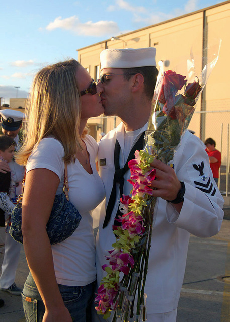 PEARL HARBOR, Hawaii (Dec. 12, 2006)  Electronics Technician 1ST Class Ryan Sweetser greets his wife after the nuclear-powered fast-attack submarine USS BUFFALO (SSN 715) returned from a six-month deployment to the western Pacific. This marked BUFFALO's last Pearl Harbor homecoming, as it is scheduled to transfer to Guam next year.  U.S. Navy photo by Mass Communication SPECIALIST 1ST Class Cynthia Clark (Released)