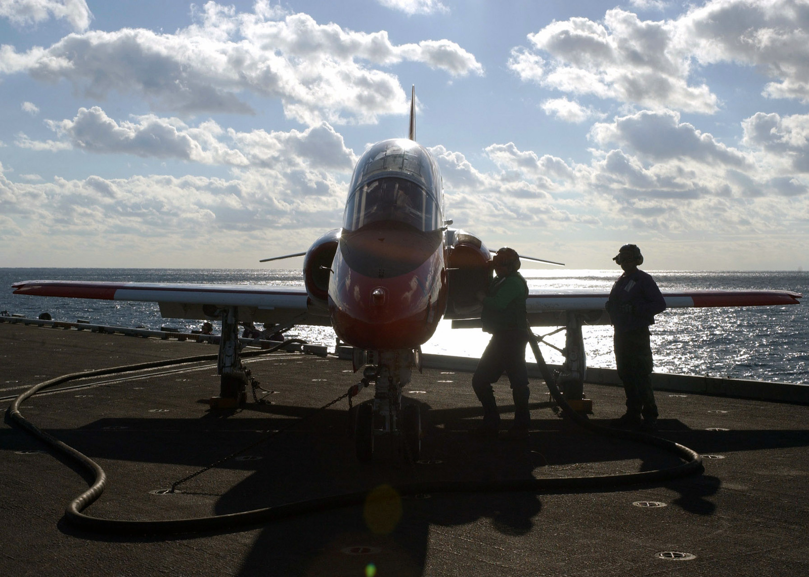 Two U.S. Navy Aviation Boatswain's Mates fuel a T-45 Goshawk trainer aircraft prior to flight operations during carrier qualifications aboard the Nimitz Class Aircraft Carrier USS THEODORE ROOSEVELT (CVN 71) on Dec. 12, 2006, while the ROOSEVELT is maintaining qualifications as part of the U.S. Navy fleet Response Plan. (U.S. Navy photo by Mass Communications SPECIALIST 3rd Class Randall Damm) (Released)