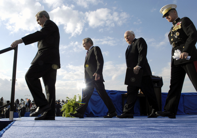 (From left-to right), U.S. President George W. Bush, The Honorable Donald H. Rumsfeld, U.S. Secretary of Defense, U.S. Vice President Richard B. Cheney, and U.S. Marine Corps GEN. Peter Pace, Chairman of the Joint Chiefs of STAFF, exits the stage during Sec. Rumsfeld's farewell parade at the Pentagon, Washington, D.C., on Dec. 15, 2006. (DoD photo by Cherie A. Thurlby) (Released)