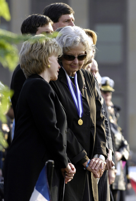 Mrs. Joyce Rumsfeld, right, wears her Distinguished Public Service award as she speaks to Mrs. Lynne Cheney, wife of U.S. Vice President Richard B. Cheney, duirng her husband's, the Honorable Donald H. Rumsfeld, U.S. Secretary of Defense, farewell ceremony at the Pentagon, Washington, D.C., on Dec. 15, 2006. (DOD photo by Cherie A. Thurlby) (Released)