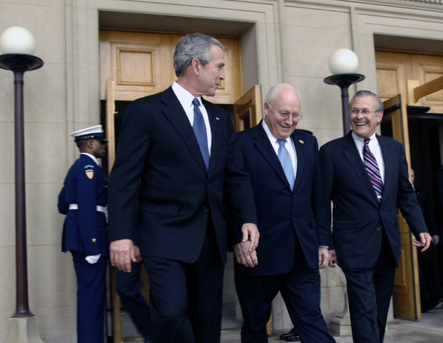 President George W. Bush (left), Vice President Dick Cheney (center) and The Honorable Donald H. Rumsfeld (right), U.S. Secretary of Defense , walk out of the Pentagon on the way to the Farewell Ceremony for the defense secretary, Dec. 15, 2006. (DoD photo by STAFF SGT. D. Myles Cullen) (Released)