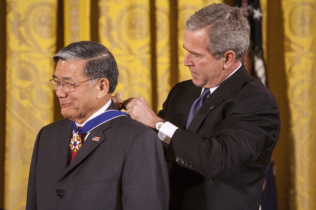 President George W. Bush Presents Norman Y. Mineta with the Presidential Medal of Freedom in the East Room of the White House