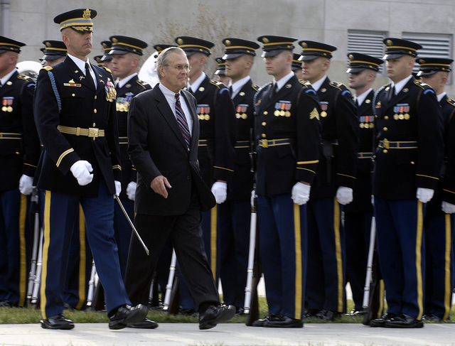 The Honorable Donald H. Rumsfeld, center, U.S. Secretary of Defense, reviews the troops with the Commander of Troops during his final farewell parade at the Pentagon, Washington, D.C., on Dec. 15, 2006. (DoD photo by Cherie A. Thurlby) (Released)