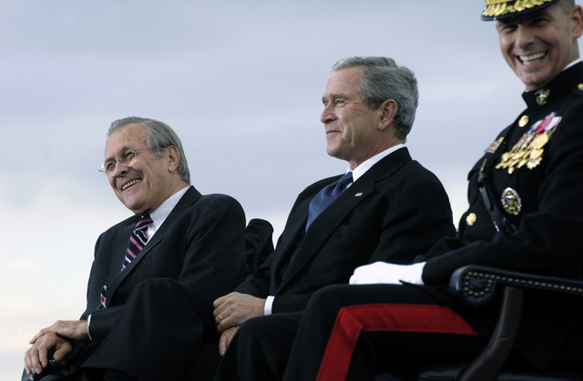 The Honorable Donald H. Rumsfeld, left, U.S. Secretary of Defense, shares a laugh with U.S. President George W. Bush, center, and U.S. Marine Corps GEN. Peter Pace, Chairman of the Joint Chiefs of STAFF, during his farewell parade at the Pentagon, Washington, D.C., on Dec. 15, 2006. (DoD photo by Cherie A. Thurlby) (Released)