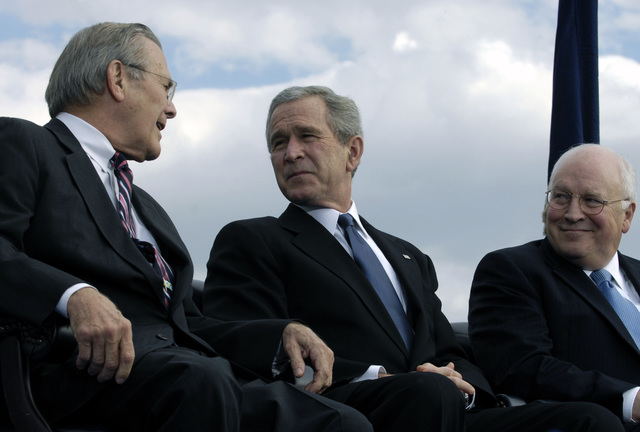 The Honorable Donald H. Rumsfeld, left U.S. Secretary of Defense, talks to U.S. President George W. Bush, center, and U.S. Vice President Richard B. Cheney, during his farewell parade at the Pentagon, Washington, D.C., on Dec. 15, 2006. (DoD photo by Cherie A. Thurlby) (Released)