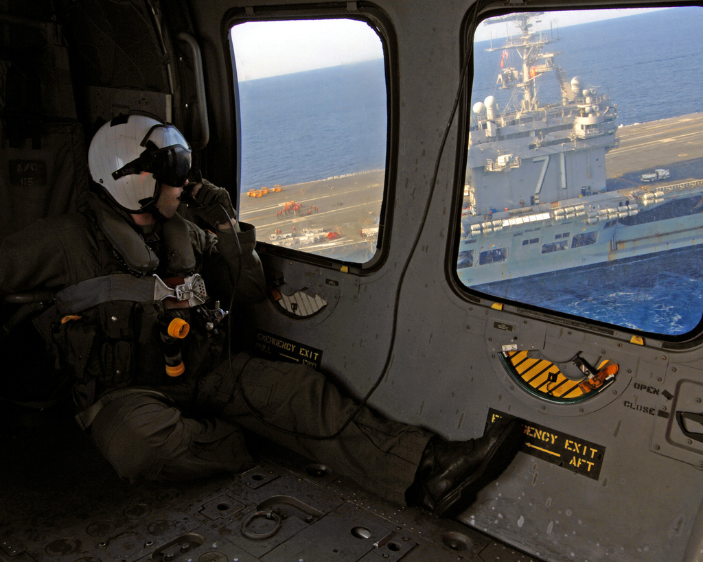 U.S. Navy Aviation Warfare SPECIALIST 2nd Class Justin McMahon, assigned to Helicopter Sea Combat Squadron 26, conducts Vertical Replenishment drills to the Military Sealift Command Kilauea Class Ammunition Ship, USNS MOUNT BAKER (T-AE 34) from the Nimitz Class Aircraft Carrier USS THEODORE ROOSEVELT (CVN 71) in the Atlantic Ocean, Dec. 17, 2006. (U.S. Navy photo by Mass Communication SPECIALIST SEAMAN Zach Hernandez) (Released)