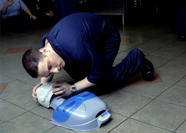 Onboard the U.S. Navy Nimitz Class Aircraft Carrier, USS DWIGHT D. EISENHOWER (CVN 69), Storekeeper SEAMAN Jeff Rein from supply department S-1 division, practices life saving skills on a training dummy during a cardio pulmonary resuscitation class on December 18, 2006. The Eisenhower and embarked Carrier Air Wing 7 are underway in the Persian Gulf on a regularly scheduled deployment in support of Maritime Security Operations and Operation Iraqi Freedom. U.S. Navy PHOTO by Mass Communication SPECIALIST SEAMAN Seth Scarlett) (Released)