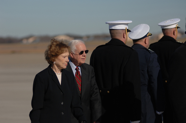 Former president Jimmy Carter and former First Lady Rosalynn Carter bid a final farewell to former President Gerald R. Ford, the 38th president of the United States, during a military departure ceremony held in his honor at Andrews Air Force Base, Md., J an. 2, 2007.  The Fords will continue on to Grand Rapids, Michigan, the hometown of the former commander in chief, where the grounds of the Gerald R. Ford Museum in Grand Rapids, Mich., will be the final place of internment for President Ford.  (U.S. Air Force photo by TECH. SGT. Jason W. Edwards) (Released)
